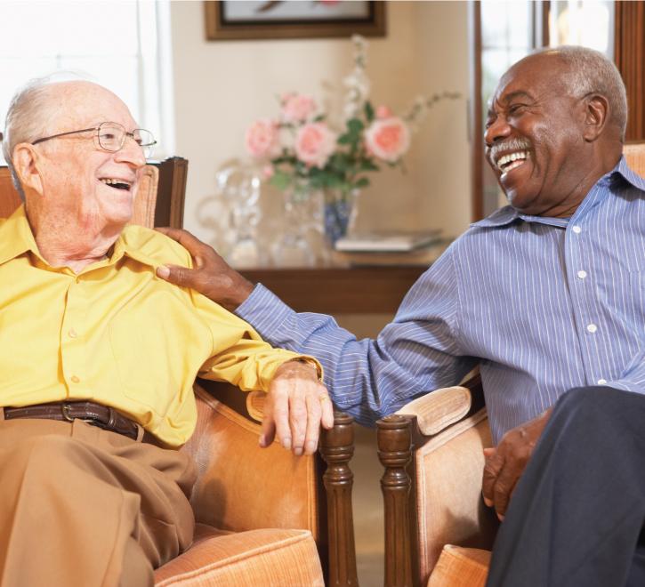 Senior men chatting in the common area