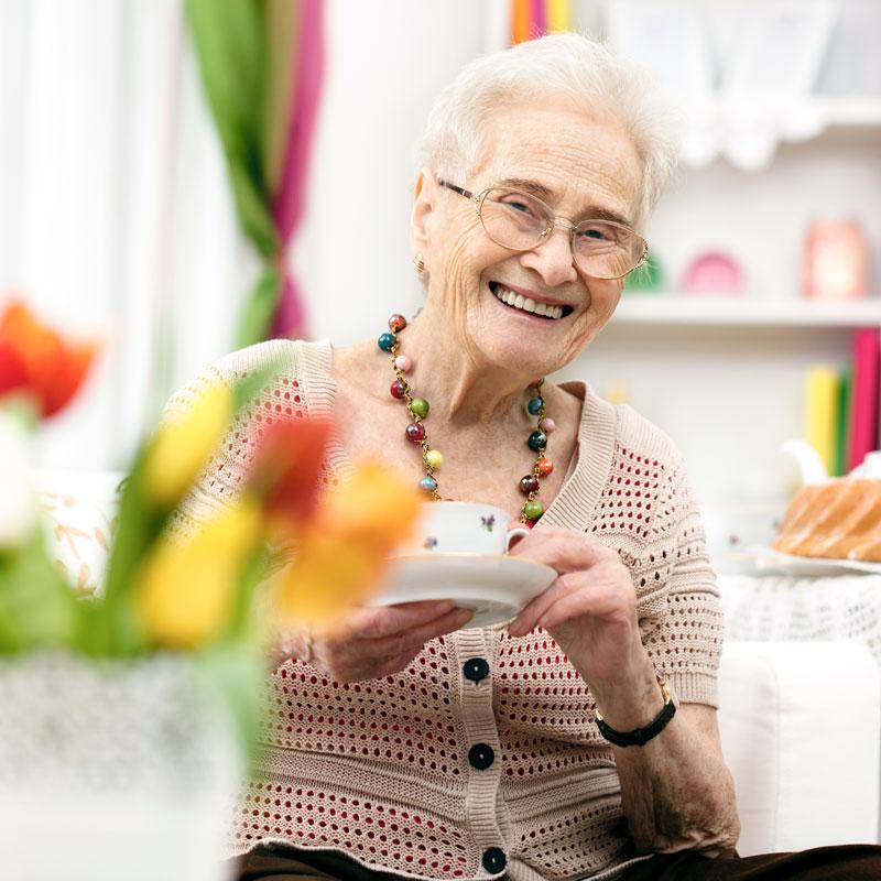 Senior woman drinking tea in her apartment