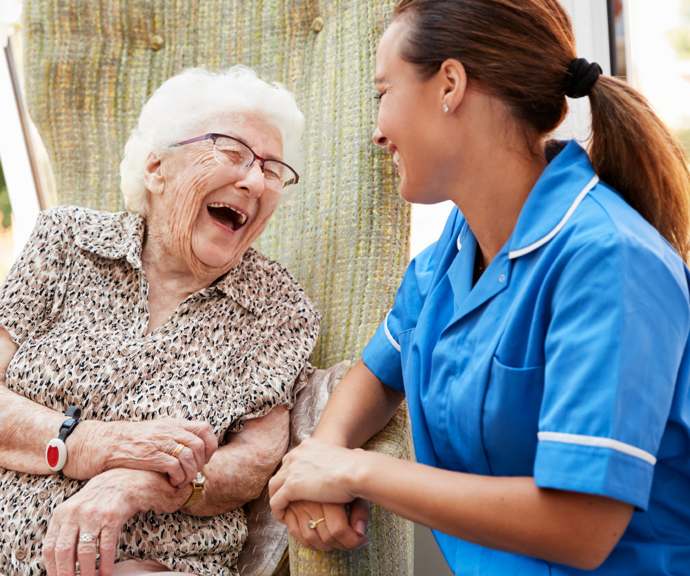 Senior resident laughing with a team member